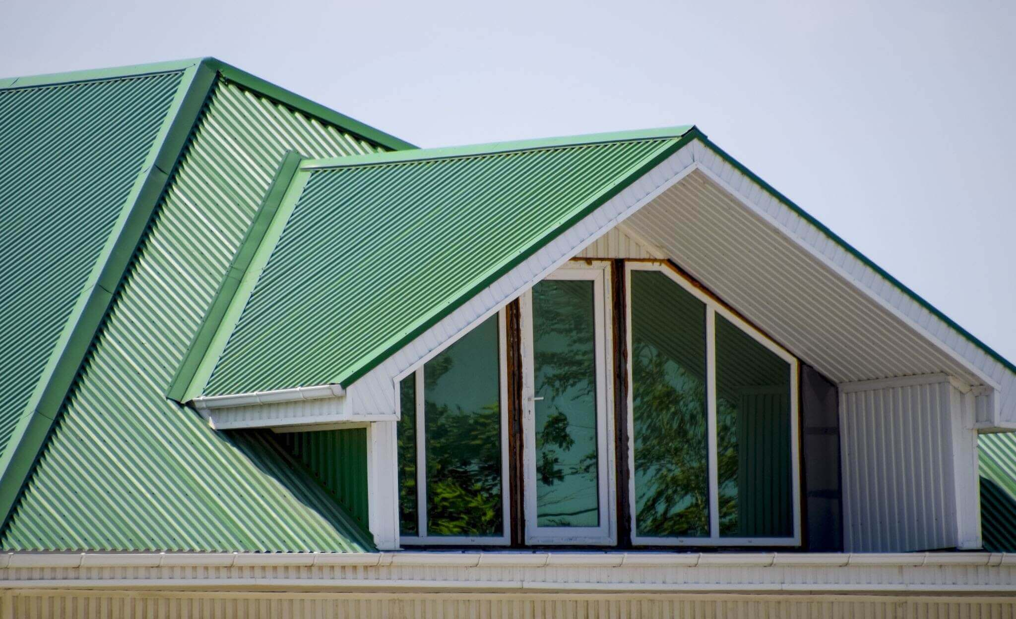 Green metal roof on building
