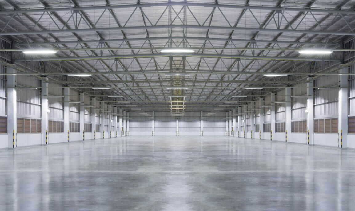 Large, empty warehouse with smooth, shiny floor